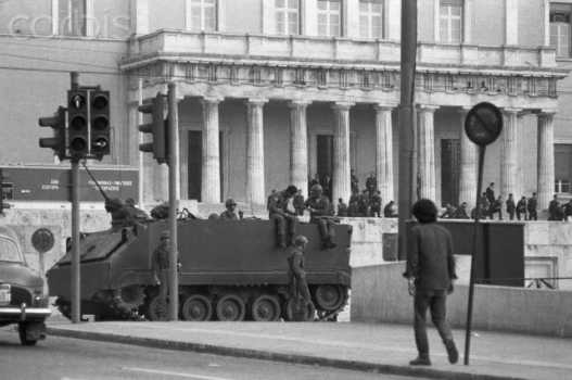 "18 Nov 1973, Athens, Attica, Greece --- Original caption: A Greek Army tank is stationed here outside the Presidential Building after martial law was proclaimed following unrest that began with student demonstrations in Greece. George Papadopoulos was ousted as President in a bloodless coup on November 25, 1973, and a new military backed government told the nation on November 27, 1973 that it would rule by decree until the people were ""prepared"" for elections. --- Image by © Bettmann/CORBIS"